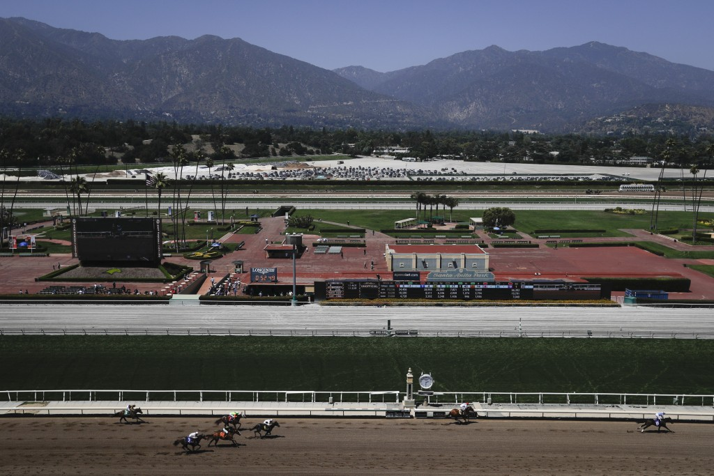 Horses finish the fourth race during the last day of the winter/spring meet at the Santa Anita horse racing track Sunday, June 23, 2019, in Santa Anit...