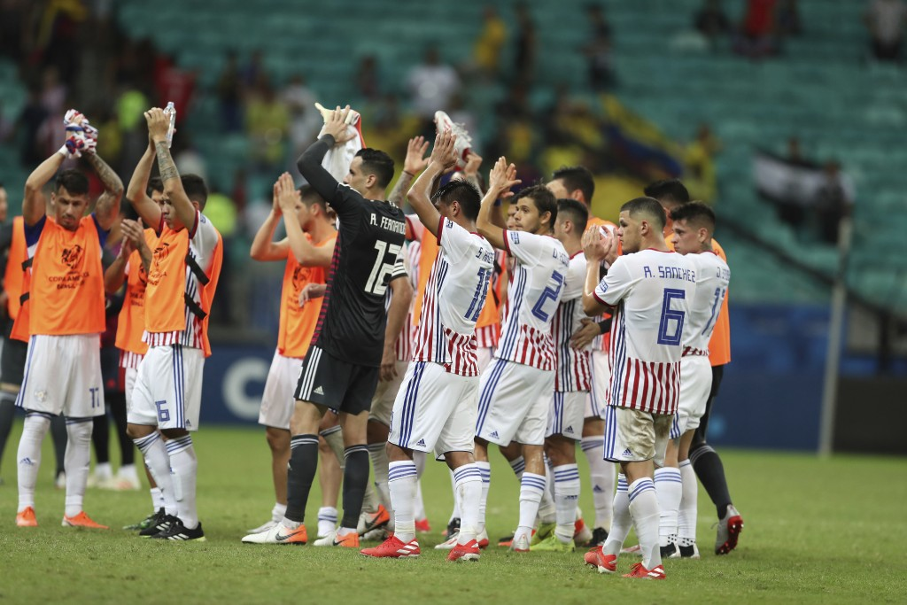 Paraguay players acknowledge the crowd after a Copa America Group B soccer match against Colombia at the Arena Fonte Nova in Salvador, Brazil, Sunday,...