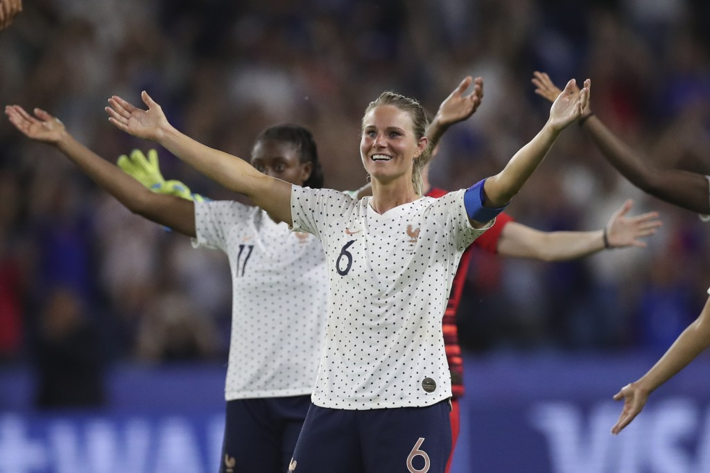 France's Amandine Henry celebrates at the end of the Women's World Cup round of 16 soccer match between France and Brazil at the Oceane stadium in Le ...