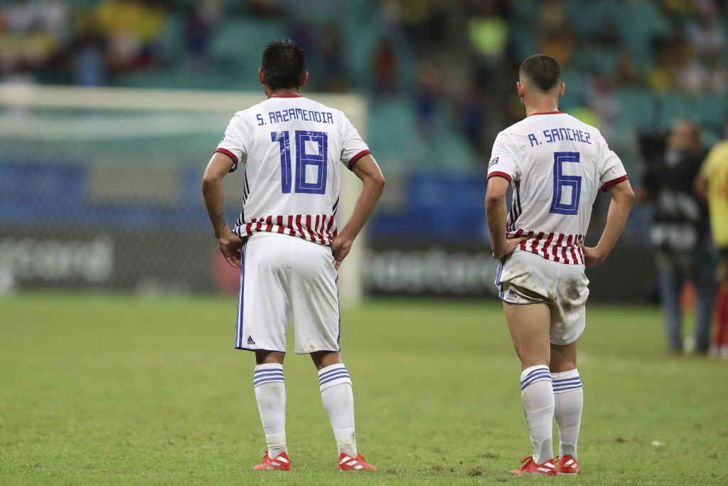 Paraguay's Santiago Arzamendia, left, and Richard Sanchez stands on the pitch at the end of a Copa America Group B soccer match at the Arena Fonte Nov...