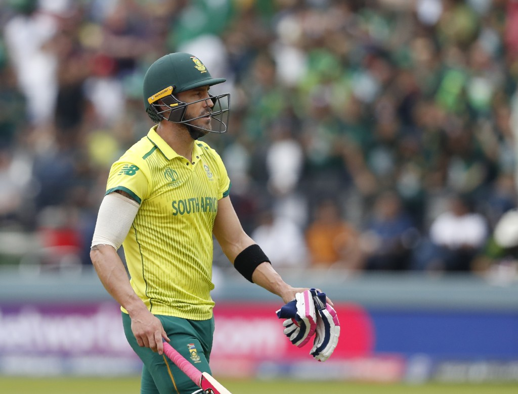 South Africa's captain Faf du Plessis walks off the pitch after being given out caught by Pakistan's captain Sarfaraz Ahmed during their Cricket World...
