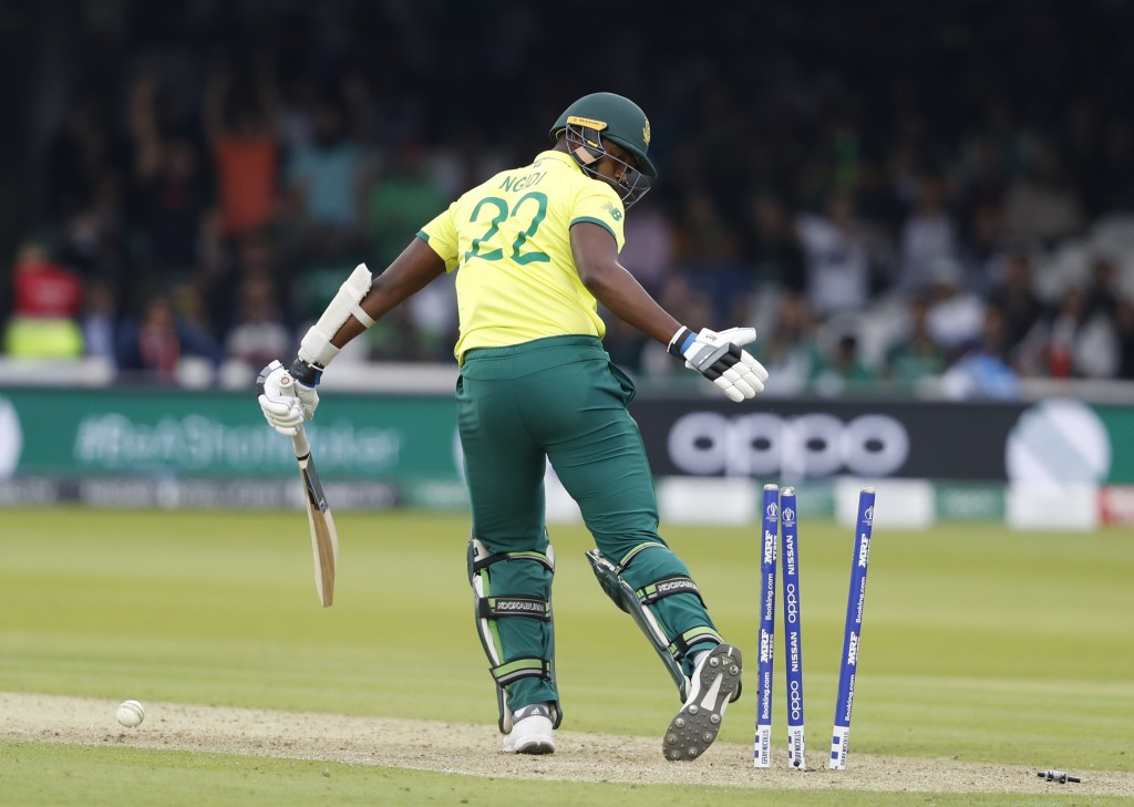 South Africa's Lungi Ngidi looks round after being clean bowled by Pakistan's Wahab Riaz during their Cricket World Cup match between Pakistan and Sou...