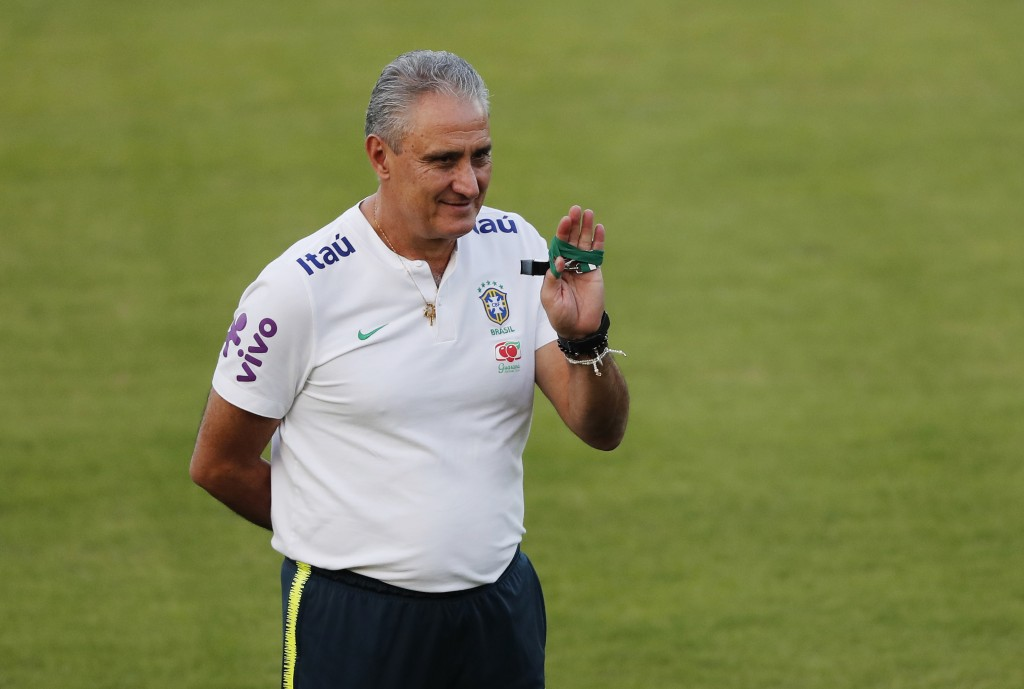 Brazil's coach Tite waves to fans during a training session with his national soccer team in Sao Paulo, Brazil, Sunday, June 23, 2019. Brazil will pla...