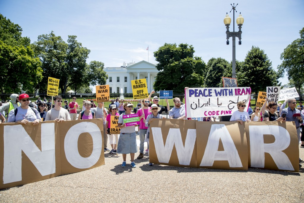 Members of the ANSWER Coalition hold an anti-war with Iran rally outside of the White House in Washington, Sunday, June 23, 2019. (AP Photo/Andrew Har...