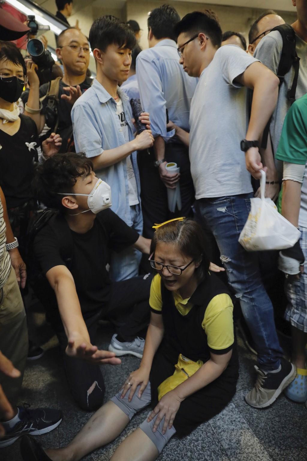 A protester sits down to block visitors in the lobby of the Hong Kong Revenue Tower in Hong Kong on Monday, June 24, 2019. Hong Kong has been rocked b...