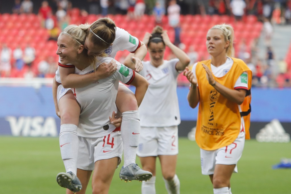 England players celebrate at the end of the Women's World Cup round of 16 soccer match between England and Cameroon at the Stade du Hainaut stadium in...