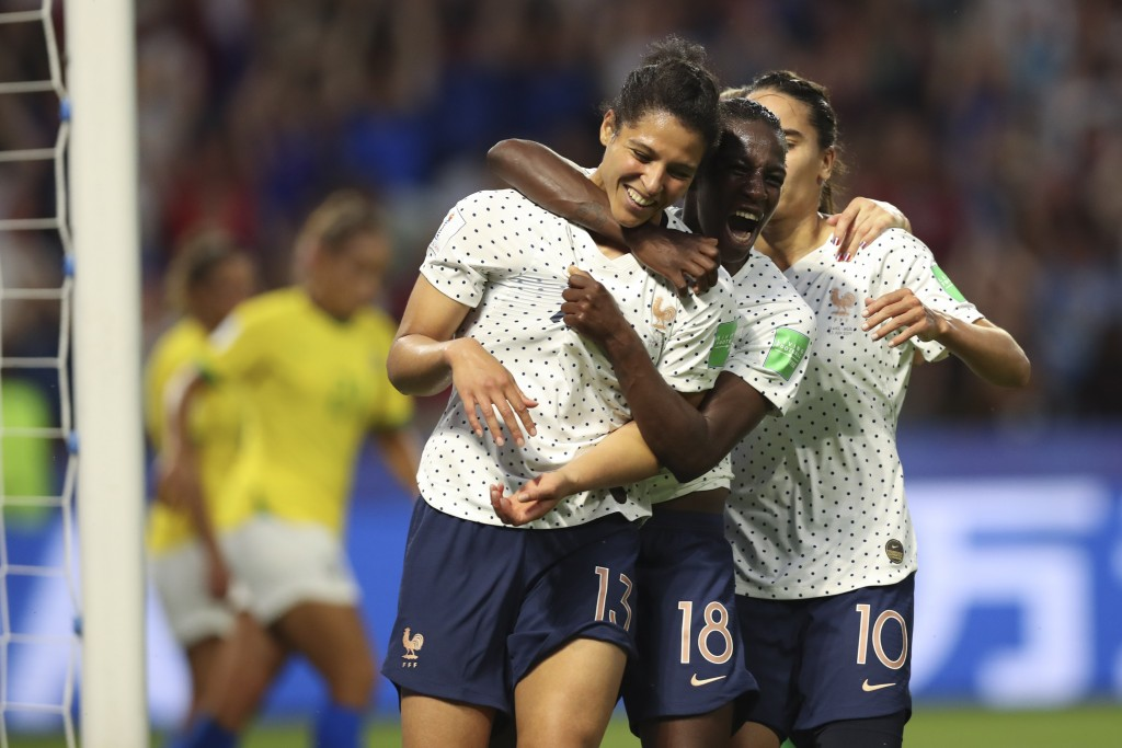 France's Valerie Gauvin, left, celebrates with France's Viviane Asseyi, center, and France's Amel Majri after scoring her side's first goal during the...