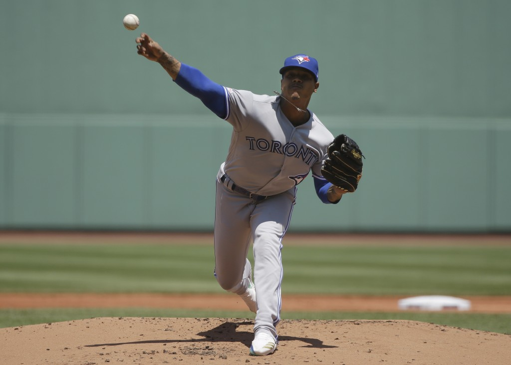 Toronto Blue Jays' Marcus Stroman delivers a pitch against the Boston Red Sox in the first inning of a baseball game in Boston, Sunday, June 23, 2019....