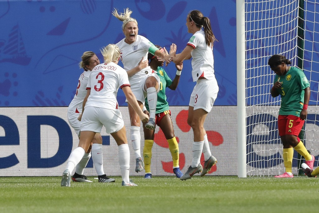 England's Steph Houghton, third from left, celebrates with teammates after scoring her side's first goal during the Women's World Cup round of 16 socc...