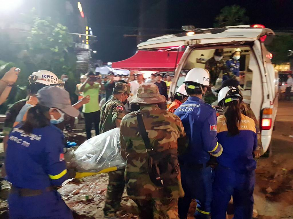 In this Sunday, June 23, 2019, photo provided by Preah Sihanouk provincial authorities, rescuers enter a victim body onto an ambulance at a site of a ...
