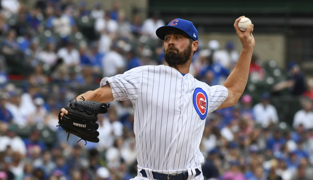 Chicago Cubs starting pitcher Cole Hamels (35) delivers during the first inning of a baseball game against the New York Mets Sunday, June 23, 2019, in...