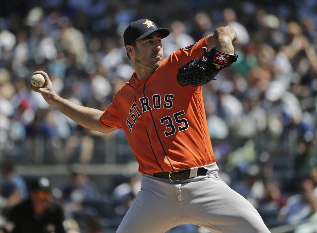 Houston Astros starting pitcher Justin Verlander throws during the third inning of a baseball game against the New York Yankees at Yankee Stadium, Sun...