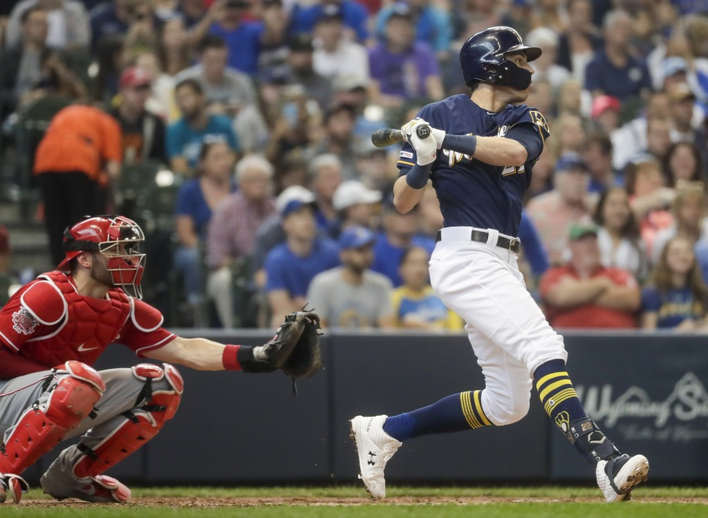 Milwaukee Brewers' Christian Yelich hits an RBI double during the third inning of a baseball game against the Cincinnati Reds Sunday, June 23, 2019, i...