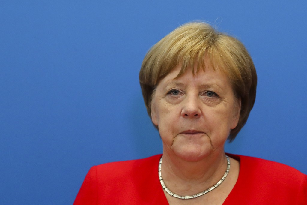 German Chancellor Angela Merkel attends a board meeting of her Christian Democratic Union at the party's headquarters in Berlin, Germany, Monday, June...