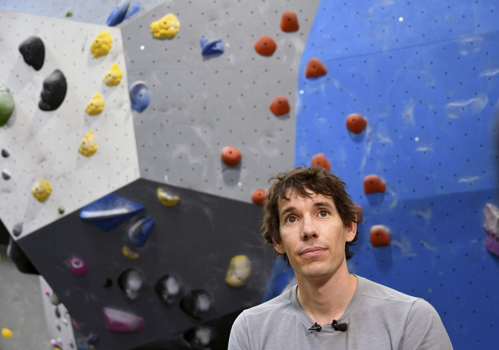 In this June 18, 2019, photo, professional rock climber Alex Honnold is interviewed at the Earth Treks gym in Englewood, Colo. Honnold is trying to ge...