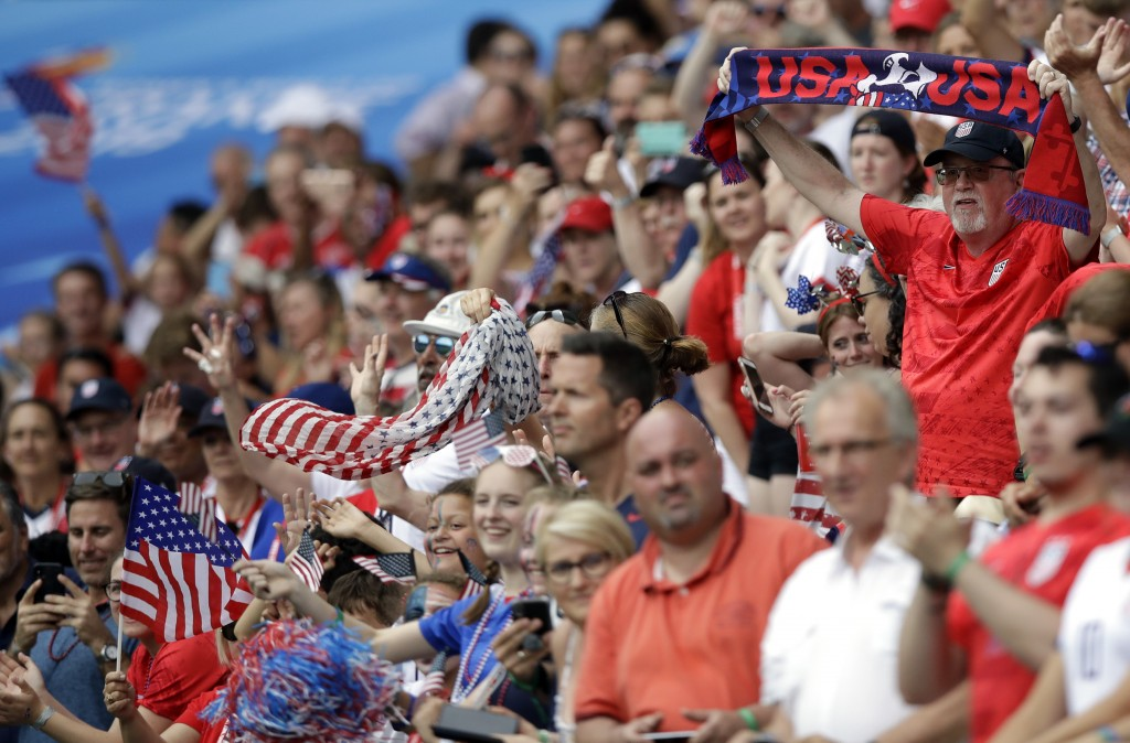 US fans wait for the start of the during the Women's World Cup round of 16 soccer match between Spain and US at the Stade Auguste-Delaune in Reims, Fr...