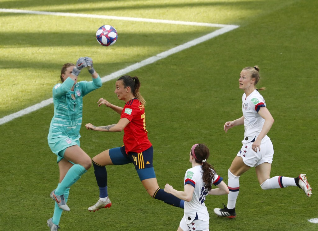 United States goalkeeper Alyssa Naeher, left, makes a save in front of Spain's Virginia Torrecilla, second left, during the Women's World Cup round of...