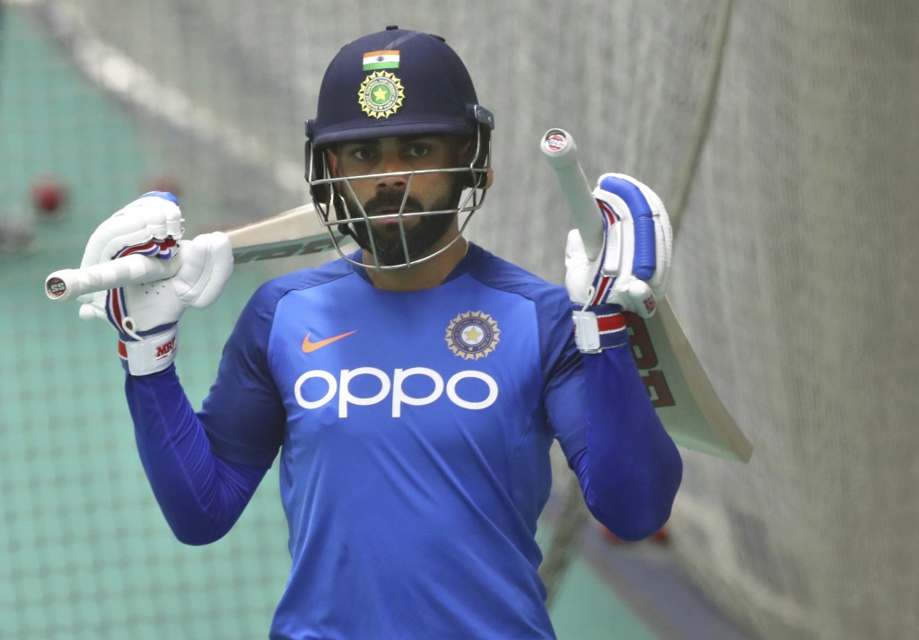 India's captain Virat Kohli leaves after batting in the nets during an indoor training session ahead of their Cricket World Cup match against West Ind...