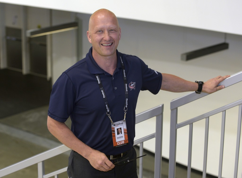 FILE - In this June 6, 2015, file photo, Columbus Blue Jackets general manager Jarmo Kekalainen poses for a photo as he watches NHL draft prospects te...