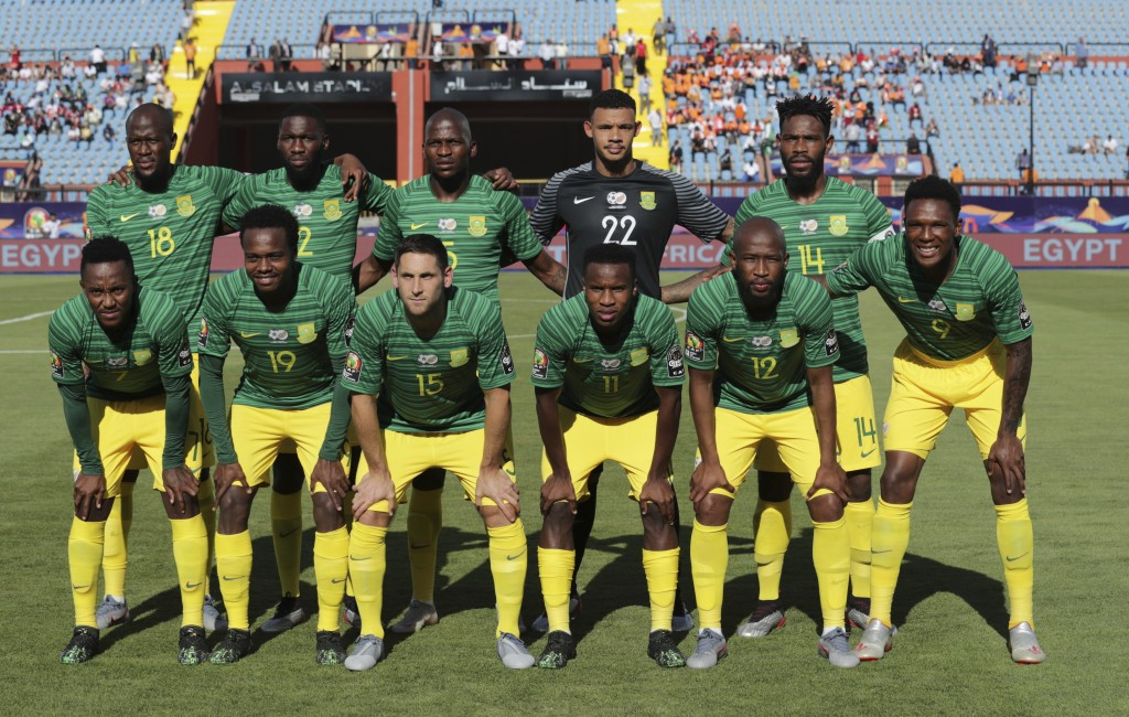 South Africa team players pose prior to the start of the African Cup of Nations group D soccer match between Ivory Coast and South Africa in Al Salam ...