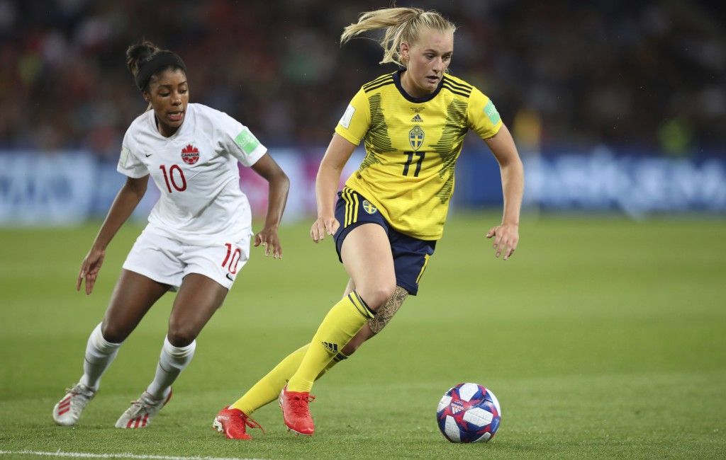Sweden's Stina Blackstenius, right, is chased by Canada's Ashley Lawrence during the Women's World Cup round of 16 soccer match between Canada and Swe...