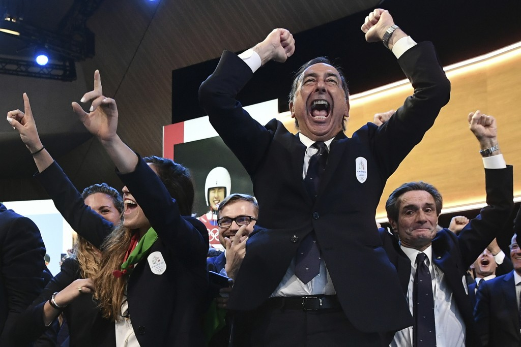 Mayor of Milan Giuseppe Sala and members of Milan-Cortina delegation celebrate after winning the bid to host the 2026 Winter Olympic Games, during the...
