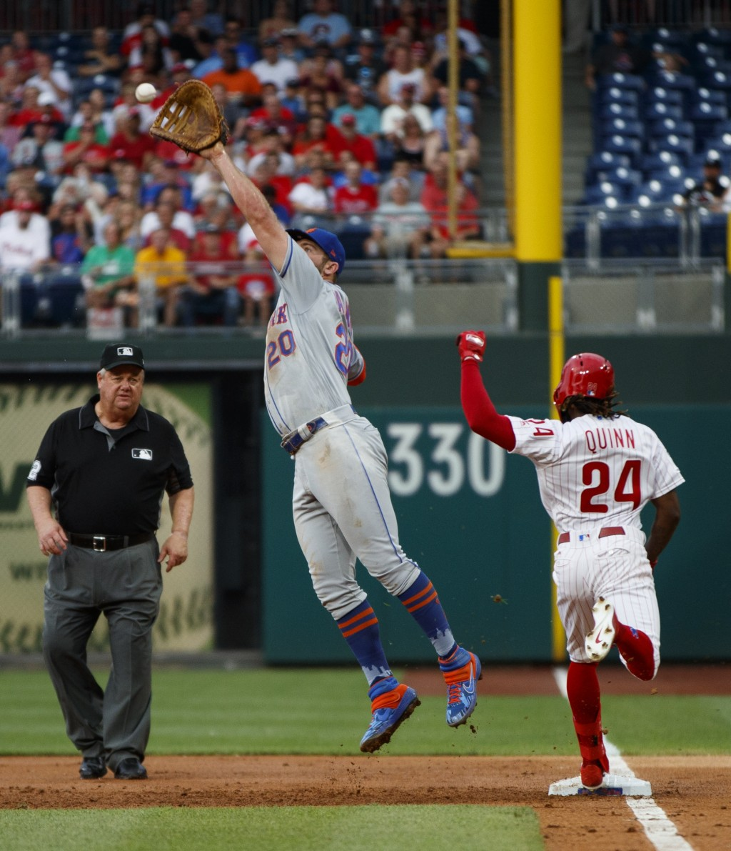 Philadelphia Phillies' Roman Quinn, right, reaches first base as New York Mets first baseman Pete Alonso leaps for the throw on Quinn's run-scoring si...