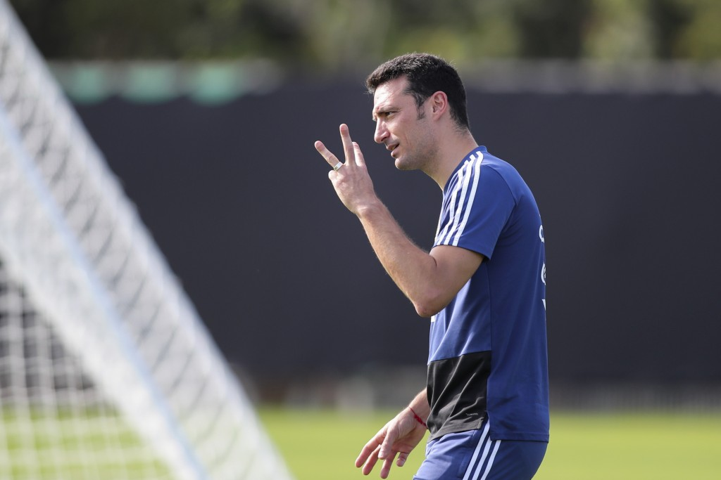 Argentina's coach Lionel Scaloni gestures to players during a Copa America's training session in Porto Alegre, Brazil, Monday, June 24, 2019. (AP Phot...