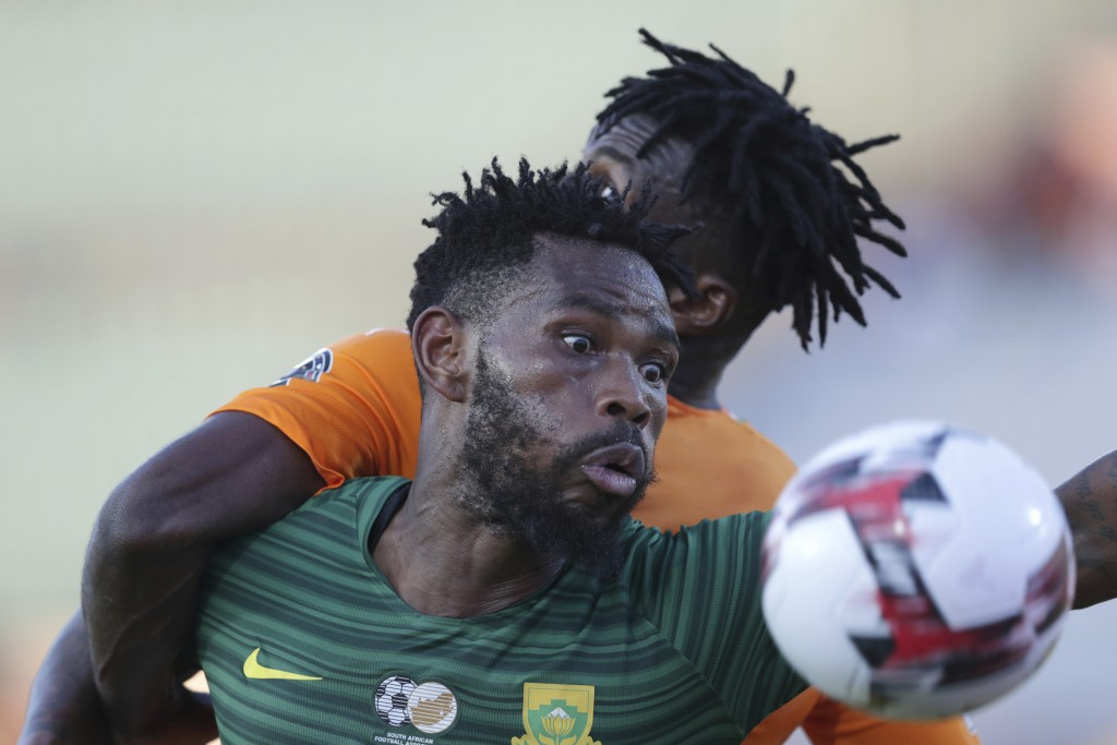 South Africa's Thulani Hlatshwayo, foreground, fights for the ball with Ivory Coast's Franck Yannick jessie during the African Cup of Nations group D ...