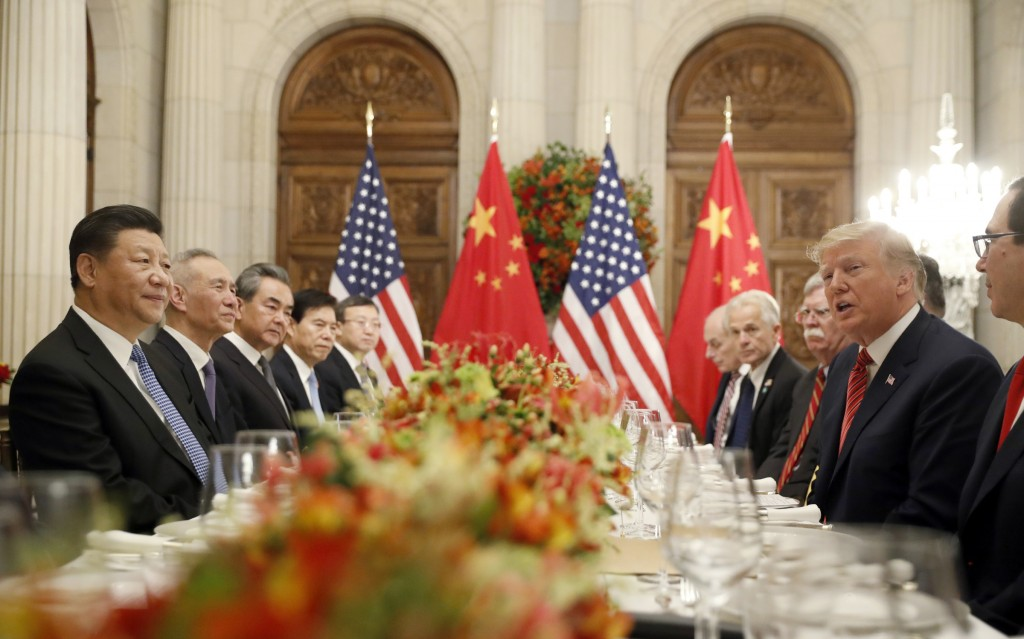 FILE - In this Dec. 1, 2018, file photo President Donald Trump speaks as China's President Xi Jinping listens during their bilateral meeting at the G2...