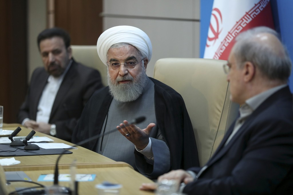 In this photo released by the official website of the office of the Iranian Presidency, President Hassan Rouhani speaks in a meeting with the Health M...