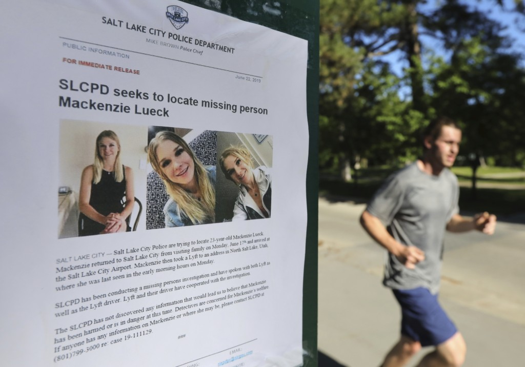 CORRECTS FIRST NAME TO MACKENZIE WITH LOWERCASE K - A joggers runs pass a poster of Mackenzie Lueck at Liberty Park Monday, June 24, 2019, in Salt Lak...