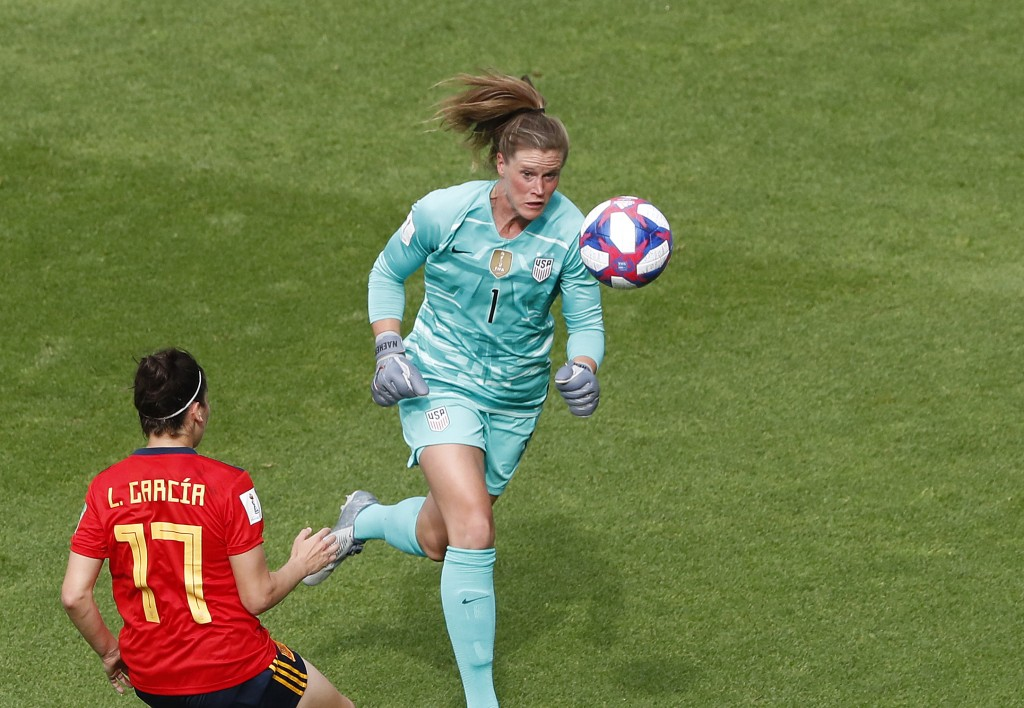 United States goalkeeper Alyssa Naeher, right, makes a save in front of Spain's Lucia Garcia during the Women's World Cup round of 16 soccer match bet...