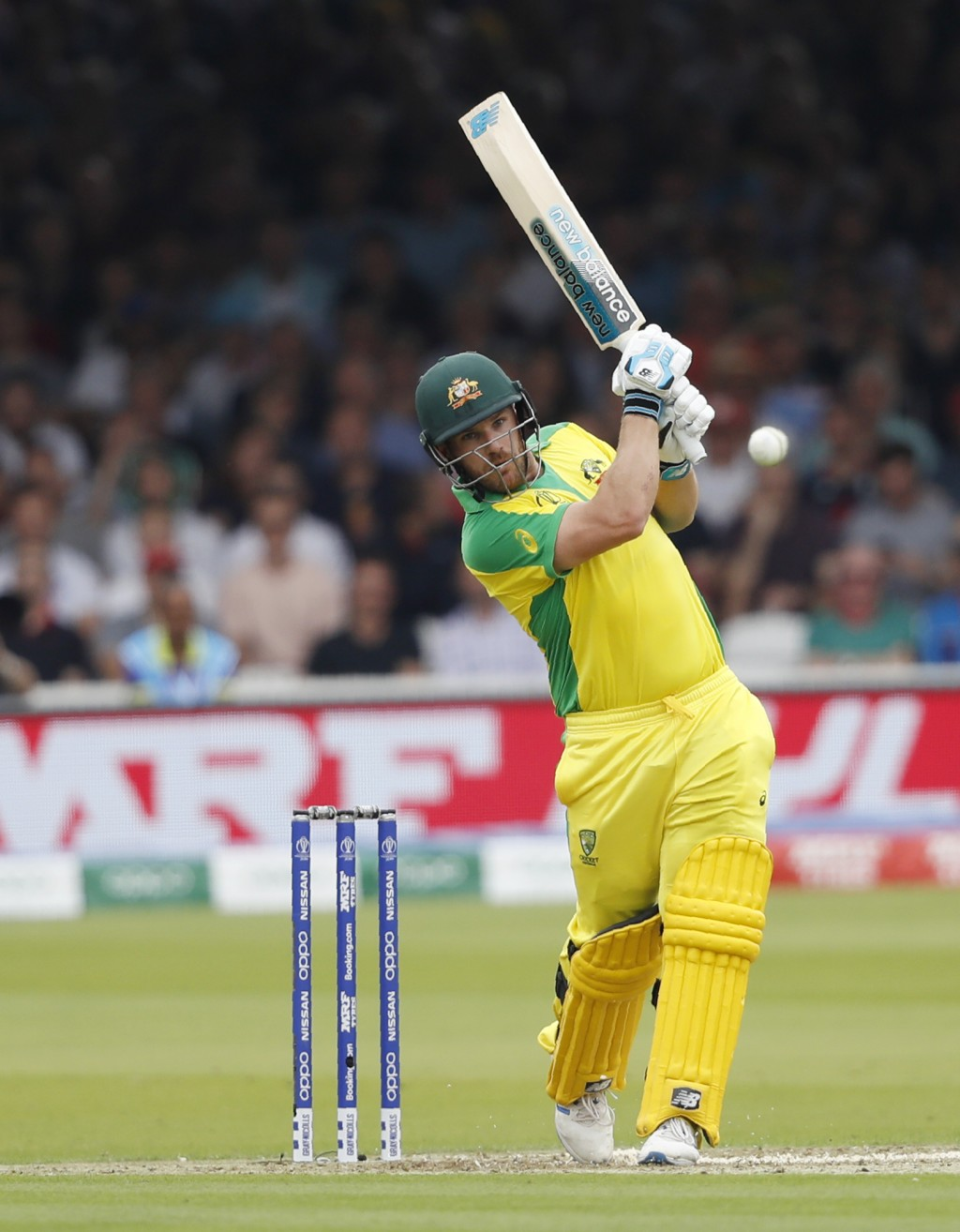 Australia's captain Aaron Finch hits runs off the bowling of England's Mark Wood during their Cricket World Cup match between England and Australia at...