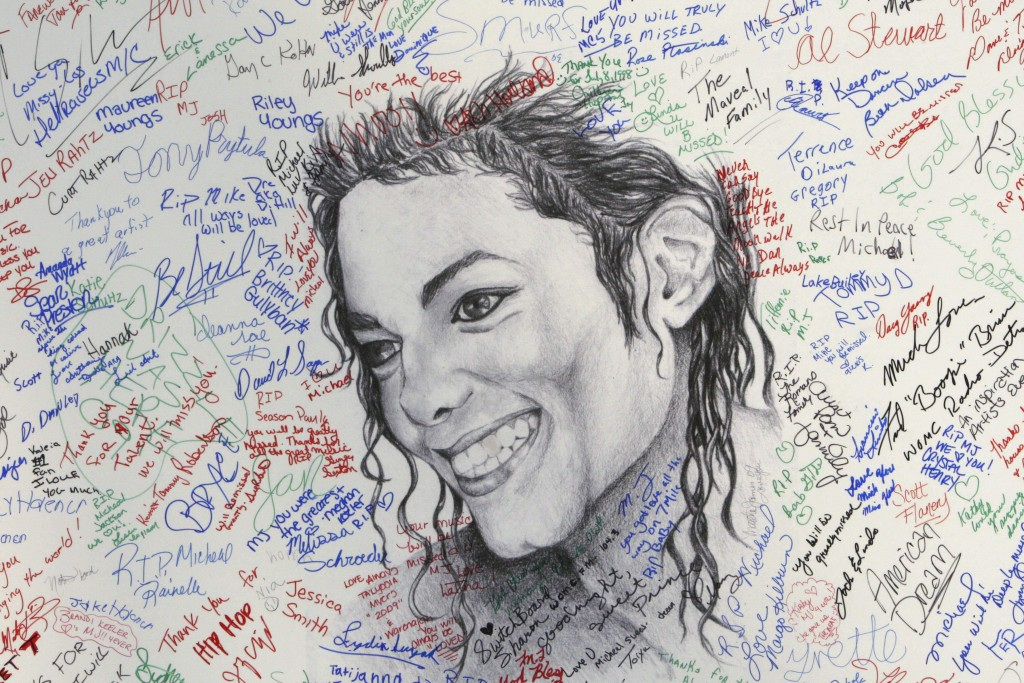 FILE - This July 7, 2009 file photo shows signatures on a poster of the late pop icon Michael Jackson at the Charles H. Wright Museum of African Ameri...