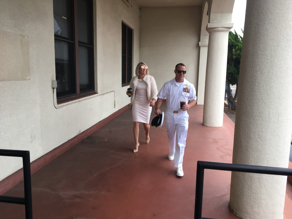 Navy Special Operations Chief Edward Gallagher, right, walks with his wife, Andrea Gallagher as they arrive to military court on Naval Base San Diego,...