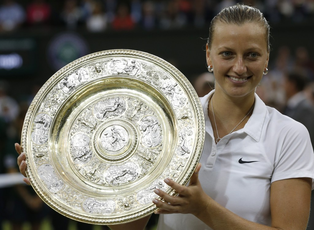 FILE - In this July 5, 2014, file photo, Petra Kvitova, of Czech Republic, holds the trophy after winning the women's singles final against Eugenie Bo...