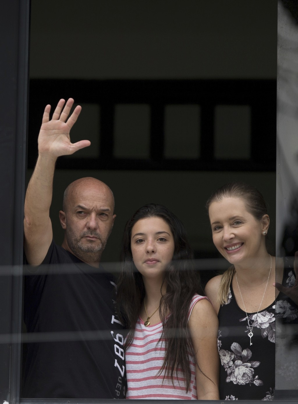 FILE - In this Sept. 20, 2014 file photo, Ivan Simonovis, former Caracas police chief, waves to the media from the balcony of his home, accompanied by...