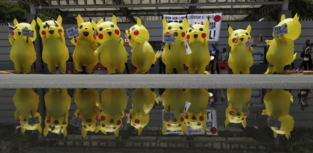 In this Tuesday, June 25, 2019, file photo, environmental activists wearing Pikachu costumes hold a rally in front of the Japanese embassy in Manila, ...