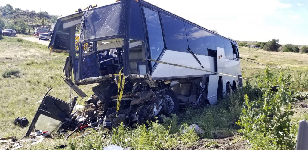This  Sunday, June 23, 2019 photo, provided by the Colorado State Patrol shows a charter bus involved in a crash along Interstate 25 north of Pueblo, ...