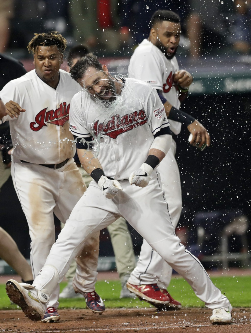 Cleveland Indians' Jason Kipnis celebrates with teammates after hitting a solo home run in the 10th inning in a baseball game against the Kansas City ...