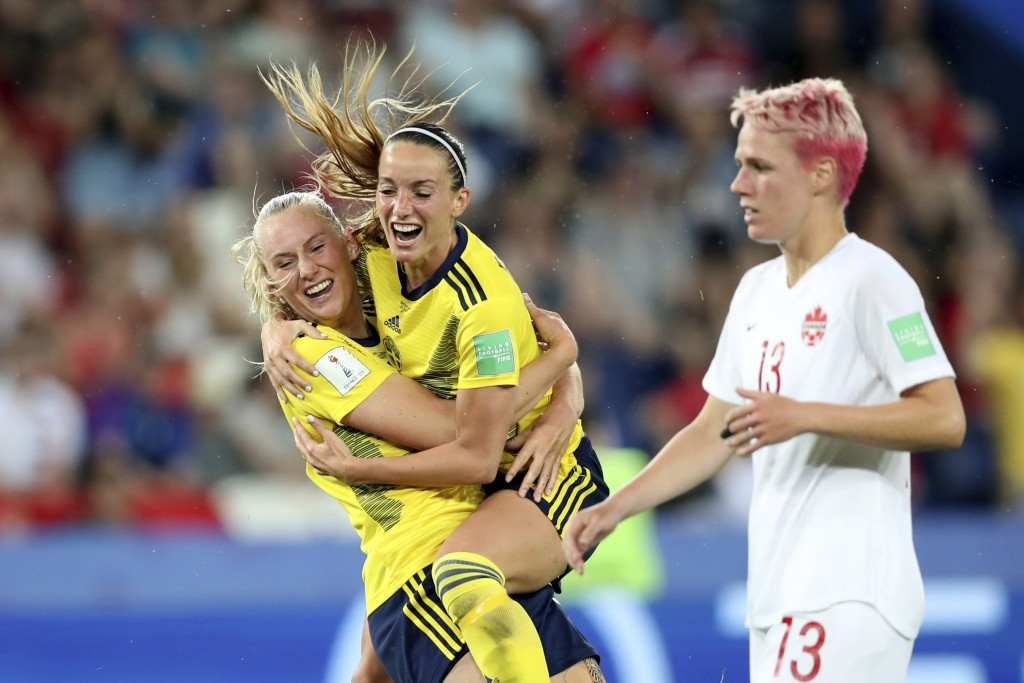 Sweden's Stina Blackstenius, left, celebrates after scoring the opening goal during the Women's World Cup round of 16 soccer match between Canada and ...