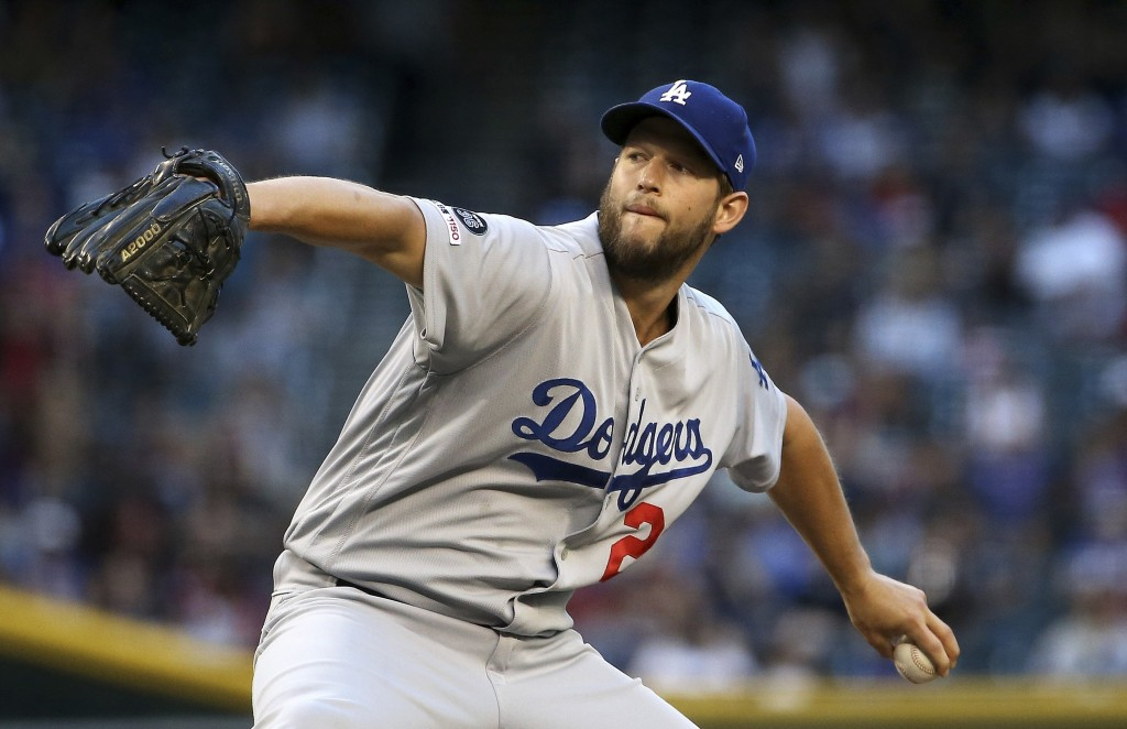 Los Angeles Dodgers starting pitcher Clayton Kershaw throws against the Arizona Diamondbacks during the first inning of a baseball game Monday, June 2...