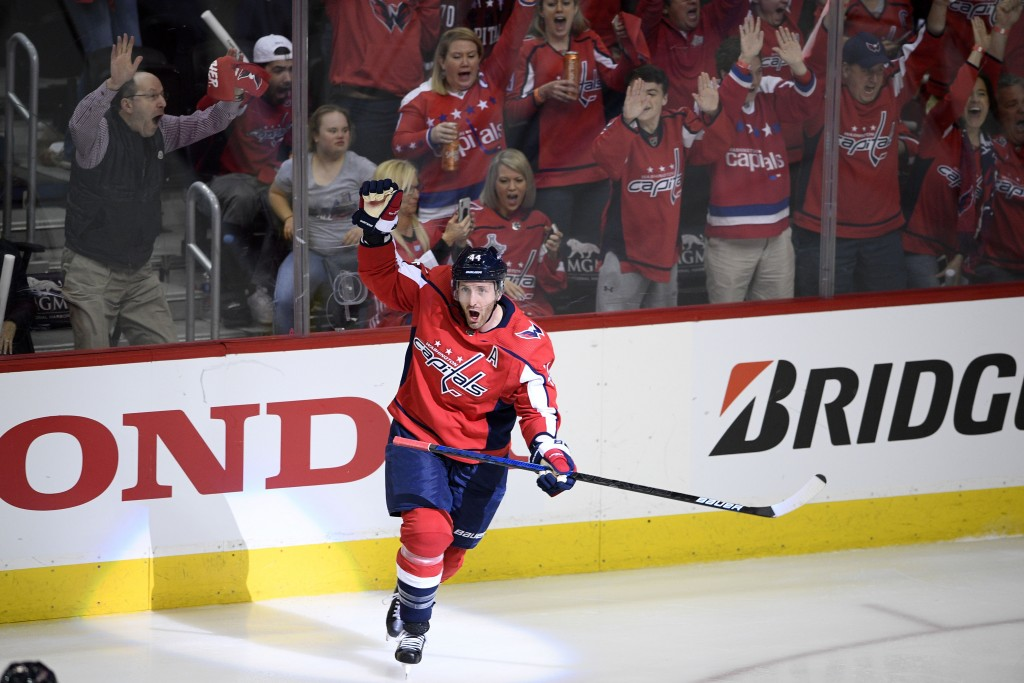 FILE - In this April 13, 2019, file photo, Washington Capitals defenseman Brooks Orpik (44) celebrates his game-winning goal in overtime of Game 2 of ...