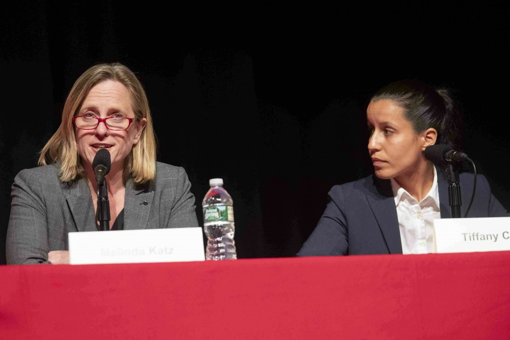 FILE - In this Thursday, June 13, 2019, file photo, public defender Tiffany Caban, right, listens as Queens Borough President Melinda Katz speaks duri...