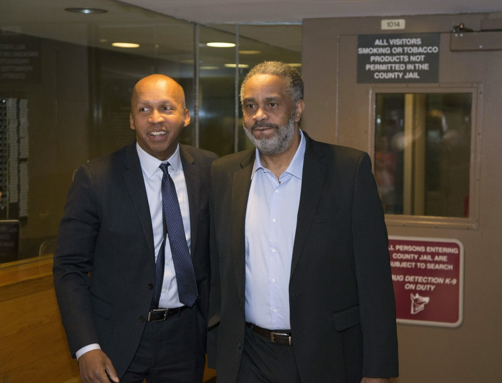 FILE - This April 3, 2015 file photo shows attorney Bryan Stevenson, left, leaving Jefferson County jail in Birmingham, Ala., with  Anthony Ray Hinton...