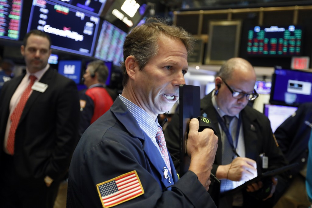 FILE - In this June 19, 2019, file photo trader Robert Chamak works on the floor of the New York Stock Exchange. The U.S. stock market opens at 9:30 a...