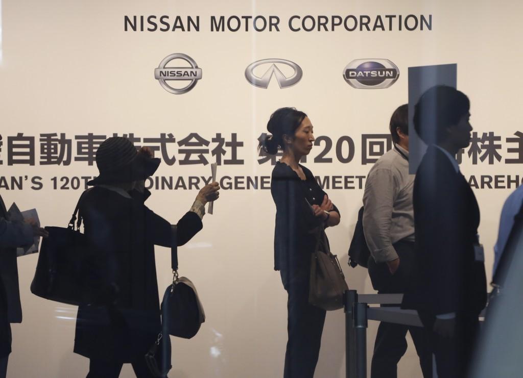 Shareholders arrive for Nissan's general meeting of shareholders in Yokohama, near Tokyo, Tuesday, June 25, 2019. Japanese automaker Nissan faces shar...