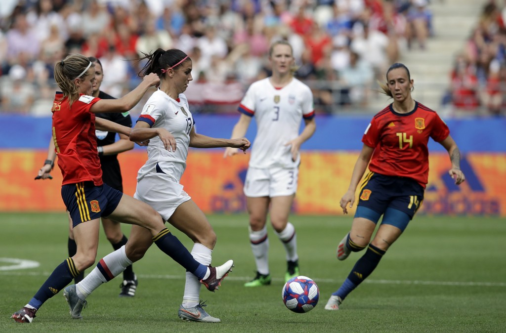 United States'Alex Morgan, right, is challenged by Spain's Irene Paredes, left, challenges during the Women's World Cup round of 16 soccer match betwe...