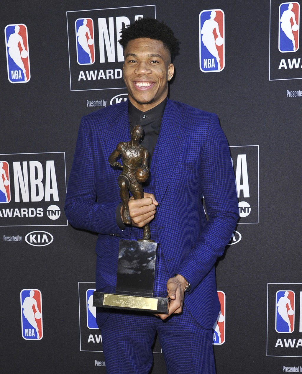 NBA player Giannis Antetokounmpo, of the Milwaukee Bucks, poses in the press room with most valuable player award at the NBA Awards on Monday, June 24...